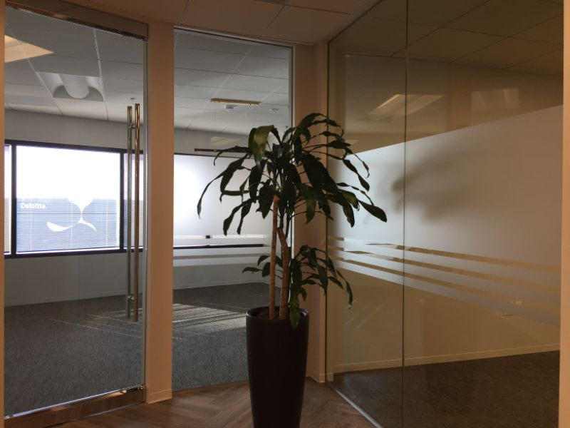 etched glass graphics and a 3D lobby logo move in Costa Mesa