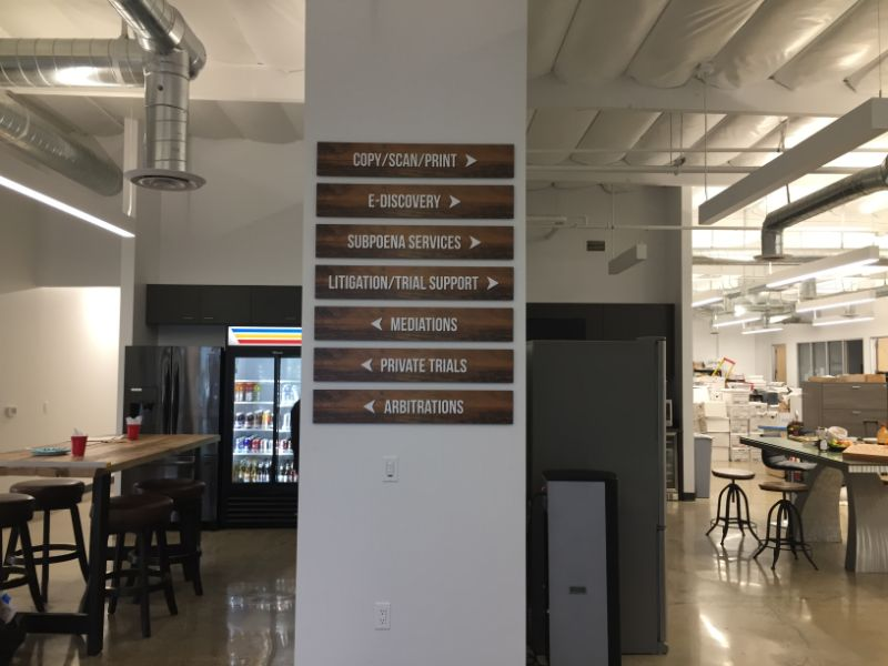 lobby logo and directional signs in Irvine