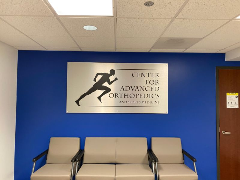 brushed metal office logo signs in Cerritos