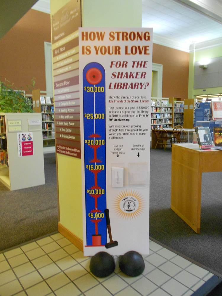 this lobby sign shows the progress of the campaign to increase donations for the library